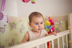 Baby stay in the bed Royalty Free Stock Photo