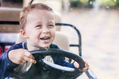 The baby at steering wheel Royalty Free Stock Photos