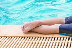 Baby steps in the pool royalty free stock images