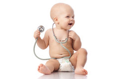 Baby with stethoscope. royalty free stock photography