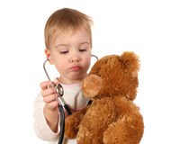 Baby with stethoscope. And toy Stock Photos