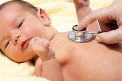 Baby with stethoscope Royalty Free Stock Photos