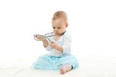 Baby with stethoscope. Royalty Free Stock Image