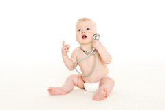 Baby with stethoscope. Royalty Free Stock Photo