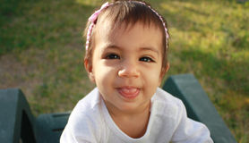 Baby sticking tongue out. Cute baby girl sticking her tongue out Stock Photography