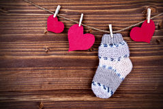Baby Stockings with Heart on a Line Stock Photos