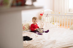 Baby with Strainer Royalty Free Stock Images