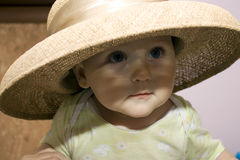 Baby in a straw hat Stock Image