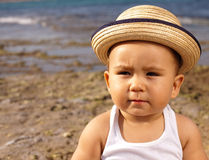 Baby with straw hat Stock Image