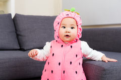 Baby with strawberry costume Stock Photo