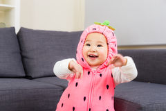 Baby with strawberry costume Stock Image