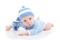 Baby  in a striped hat Royalty Free Stock Photos