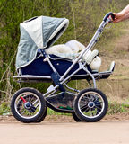 Baby stroller. In a forest going on the road Royalty Free Stock Photo