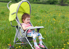 Baby in stroller Royalty Free Stock Images