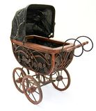 Baby stroller. Old wooden antique handmade baby stroller Stock Photography