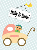 Baby in a stroller. Happy baby sitting in a stroller Royalty Free Stock Photography