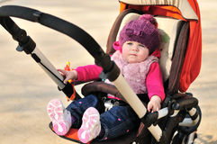 Baby in stroller Stock Photo