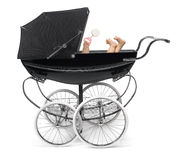 Baby in Stroller. Profile of traditional baby stroller/perambulator with baby arm and feet Stock Photos