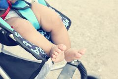 Baby on stroller Stock Image