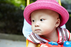 Baby in stroller looking away Royalty Free Stock Photography