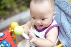 Baby in stroller Stock Image
