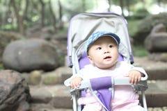 Baby in stroller Stock Photo