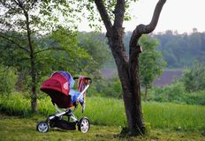 Baby stroller in the park Stock Photos