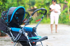 Baby stroller in the park spring day Stock Image