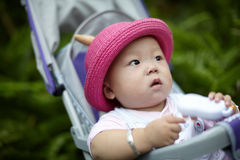 Baby  in stroller playing phone toy Stock Photography