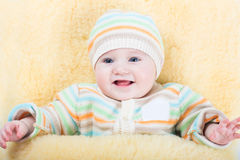 Baby in stroller sitting in warm sheep skin foot muff Stock Photo