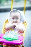 Baby in stroller standing Stock Photography