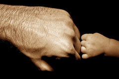 baby strong touching dad Stock Images