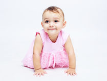 Baby in the studio. Portrait of a cute baby,  against white background Royalty Free Stock Photo