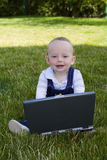 Baby study on computer Royalty Free Stock Images
