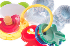 Baby Stuff. Baby toy with teether and baby shoes Royalty Free Stock Photography