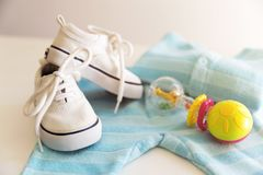 Free Baby Stuff Is On A White Background. Things For Little Boy, Rattle And Shoes. Newborn Baby Necessities. Stock Image - 117455161