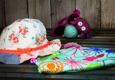 Baby stuff to the beach. On a beautiful wooden background Stock Photo