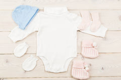 Baby stuff on wooden table Royalty Free Stock Photography