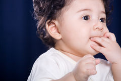 Baby suck thumb Stock Photography
