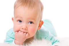 Baby sucking fingers Royalty Free Stock Images