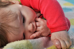 Baby sucking fingers royalty free stock photo