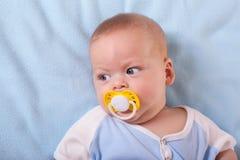Baby sucking nipple Stock Photo