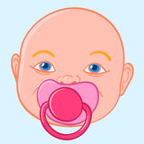 Baby sucking a pacifier Royalty Free Stock Image