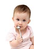 Baby sucking spoon Royalty Free Stock Image