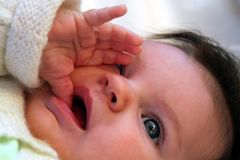 Baby sucking thumb Stock Image