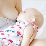 Baby sucks mother`s breast, breast milk feeding newborn baby stock images
