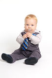 Baby in suit with tie. Blond baby with pacifier in formal suit with tie Stock Image