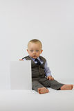 Baby In Suit With White Board Royalty Free Stock Image
