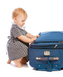 Baby and suitcase Stock Photos