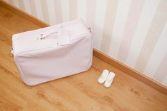 Baby suitcase and bootees Royalty Free Stock Photos